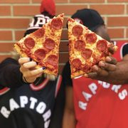 Pizza Pizza Score a Slice: Get a FREE Slice When the Toronto Raptors Win at Home and Score 100 Points (ON Only)